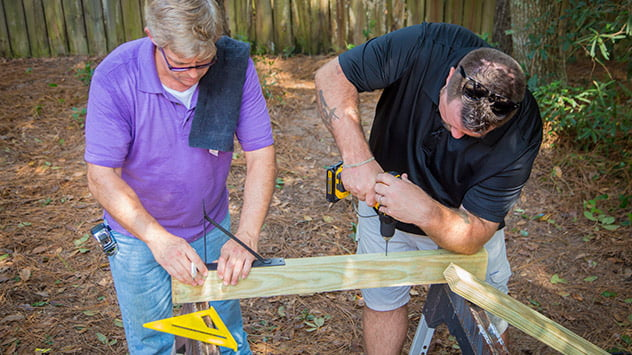Allen and Chuck work on the new gate.