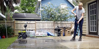 Power washing a concete patio slab