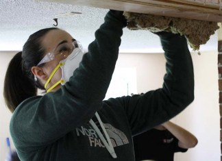 Woman adding Insulation