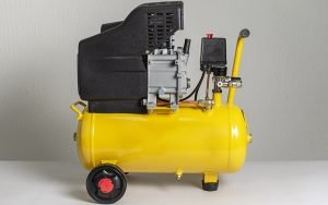 Yellow portable air compressor