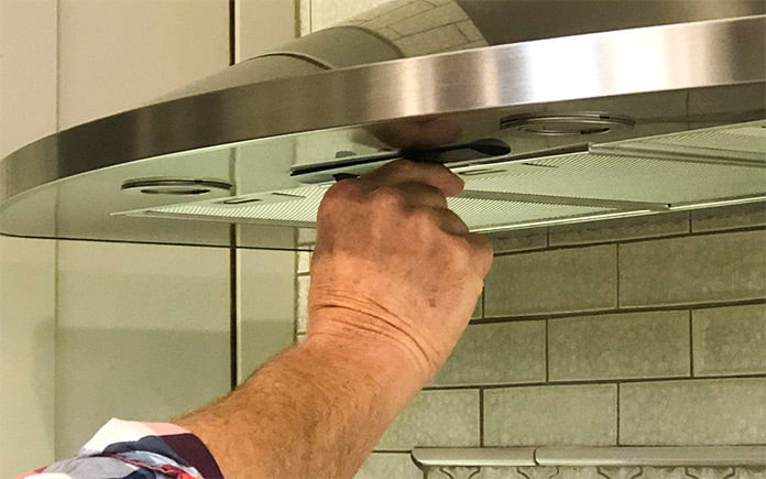 Danny Lipford, host of Today's Homeowner, turns on his range hood after an evening of cooking