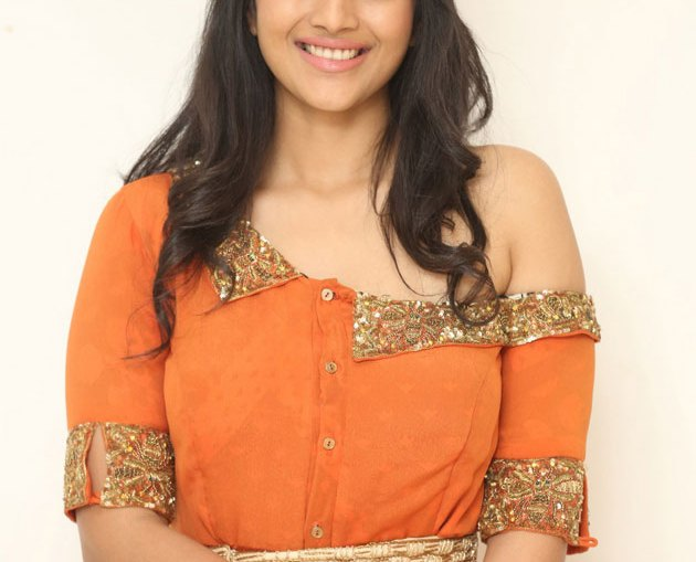 Actress Megha Akash Orange Dress Photos Stills