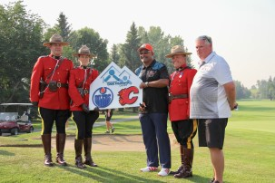 Grant Fuhr with RCMP and Terry Loewen