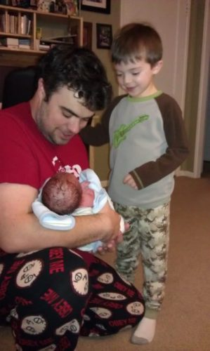 Home birth - Dad introducing big brother to baby