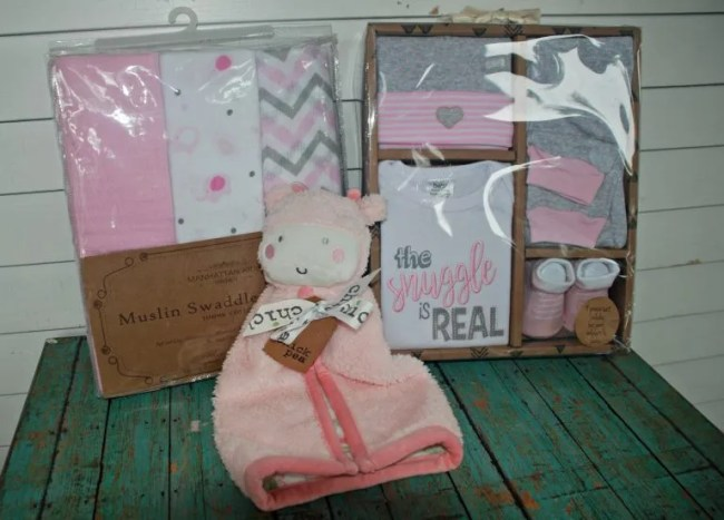 Baby gift set, swaddle blankets, and plush lovey from Marshall's