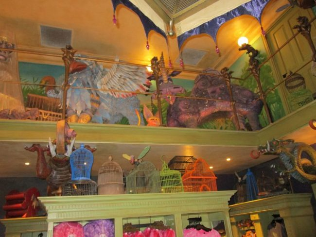 shelves with birdcages and animals at Magical Creatures at the Wizarding World of Harry Potter