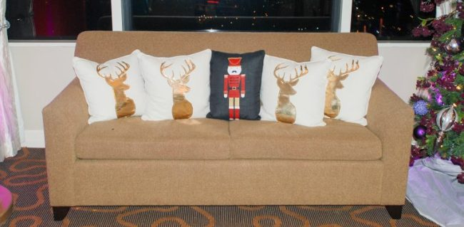 Couch with Christmas pillows in the Santa Suite at Swissotel Chicago