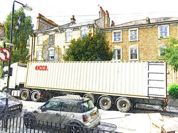 Shipping container parked on the street