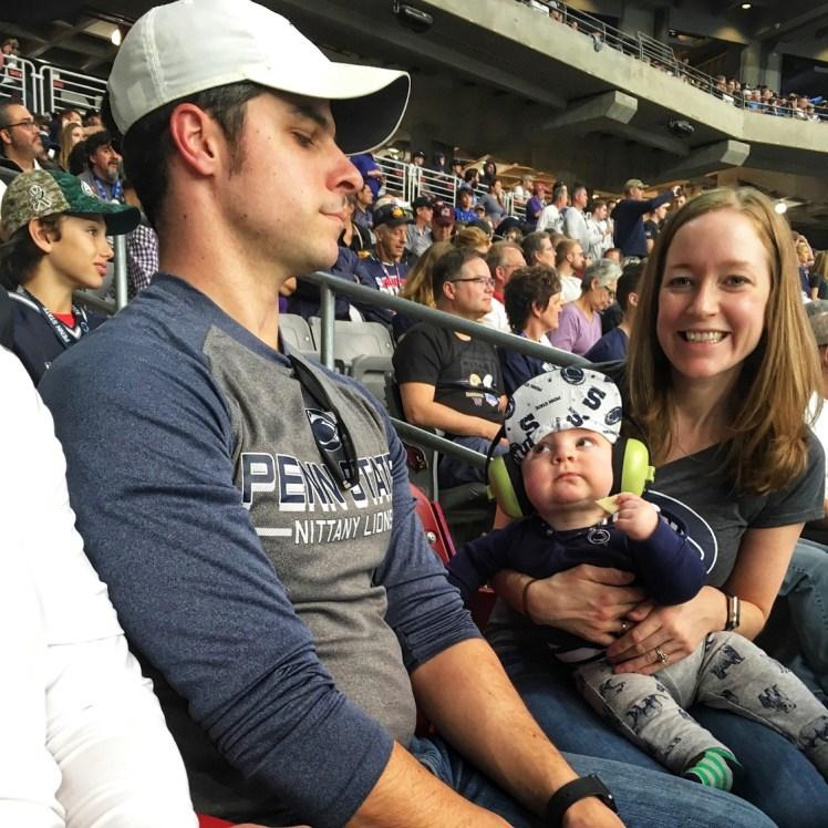 baby at football game