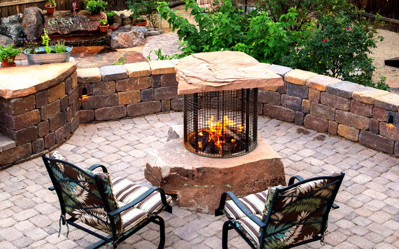 Todd's Excavating, Inc. custom built flagstone fire pit. Can be done in gas, propane or natural wood