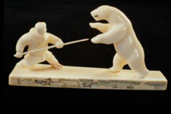 """Sculptural group """"Bear hunting with a spear"""", 1965, by Huhutan. Walrus tusk"""