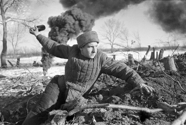 A soldier prepares to throw a grenade. Russia, Stalingrad