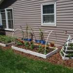 Raised beds and pyramid planter built by hand.