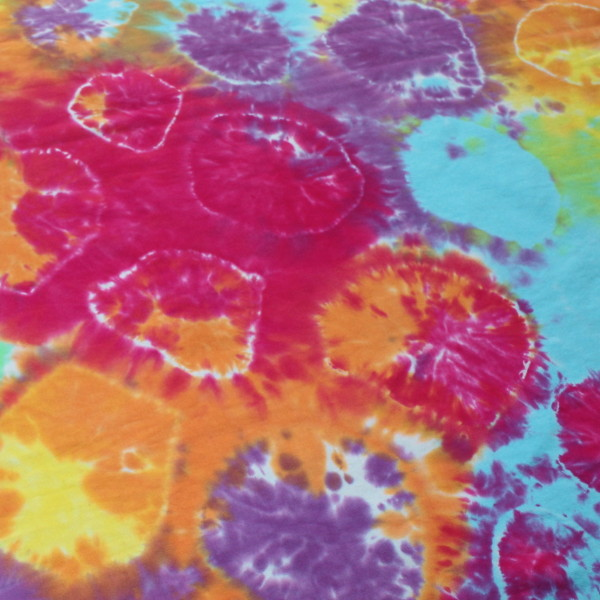 cotton jersey liquid dyed in rainbow colours with small circles tied in