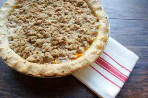 Peach Crumble Pie. The perfect cross between summer and fall. Serving with a big scoop of vanilla ice cream!