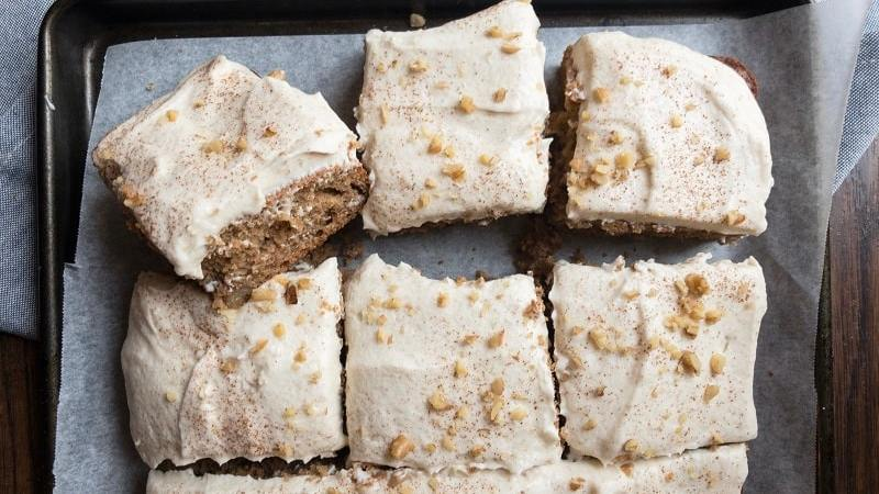 Applesauce Spice Cake made with a boxed Duncan Hines mix is the perfect holiday, fall themed treat. A great dessert for Thanksgiving, this sheet cake for a crowd is topped with whipped cinnamon buttercream.