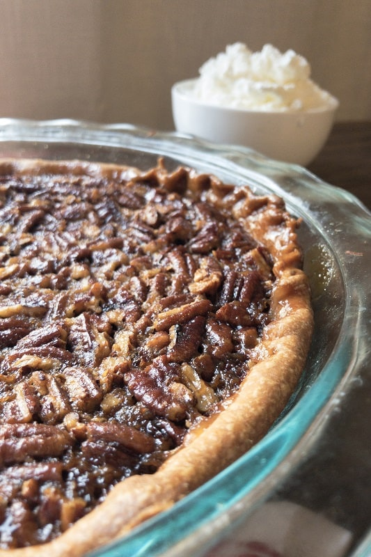A good old fashioned Classic Pecan Pie with Homemade Whipped Cream to grace your Thanksgiving dessert table!