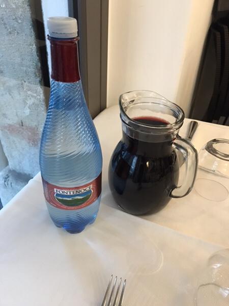 ristorante malvasia taormina water and red wine