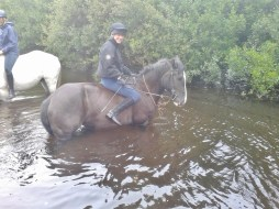 Bareback riding in the river at Eclipse Ireland