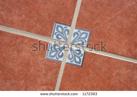 stock-photo-terracotta-tiles-on-the-floor-with-a-traditional-mexican-pattern-1172393