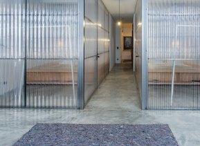MissOpo-glass-partition-hallway-Remodelista