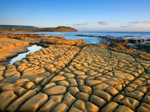 Rocks exposed at low tide on Broad Bench, Kimmeridge Bay, Isle of Purbeck, Jurassic Coast World Heritage Site, Dorset, England, October 2008
