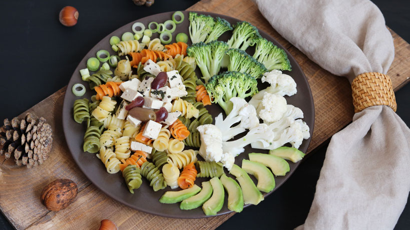 Quick vegan pasta salad with tofu, avocado, broccoli and cauliflower