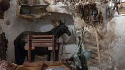 A very realistic horse stands in the corner, reminding us that they actually used its manure to heat the cave during the winter. If our heating bills get any higher, we may need to resort to this.