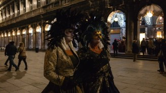 A couple of ladies heading off to a masked ball.