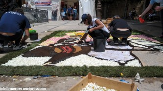 """Along the main street, you can see various artists at work and how they make the flower """"mosaics""""."""