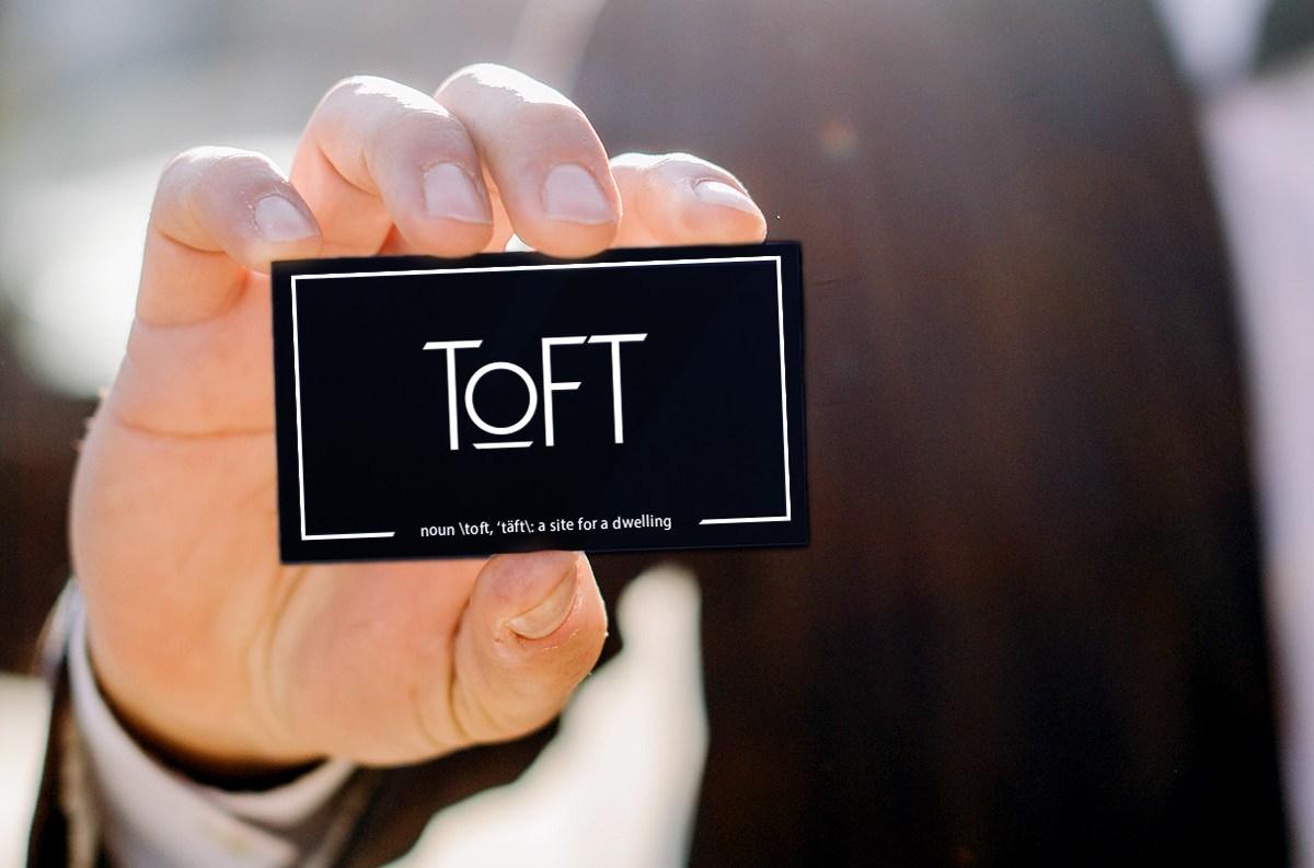 Ben holding Toft Business Card