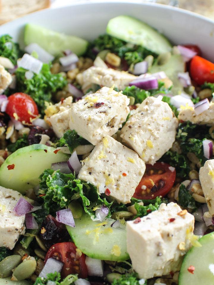 vegan feta closeup on kale farro abundance salad