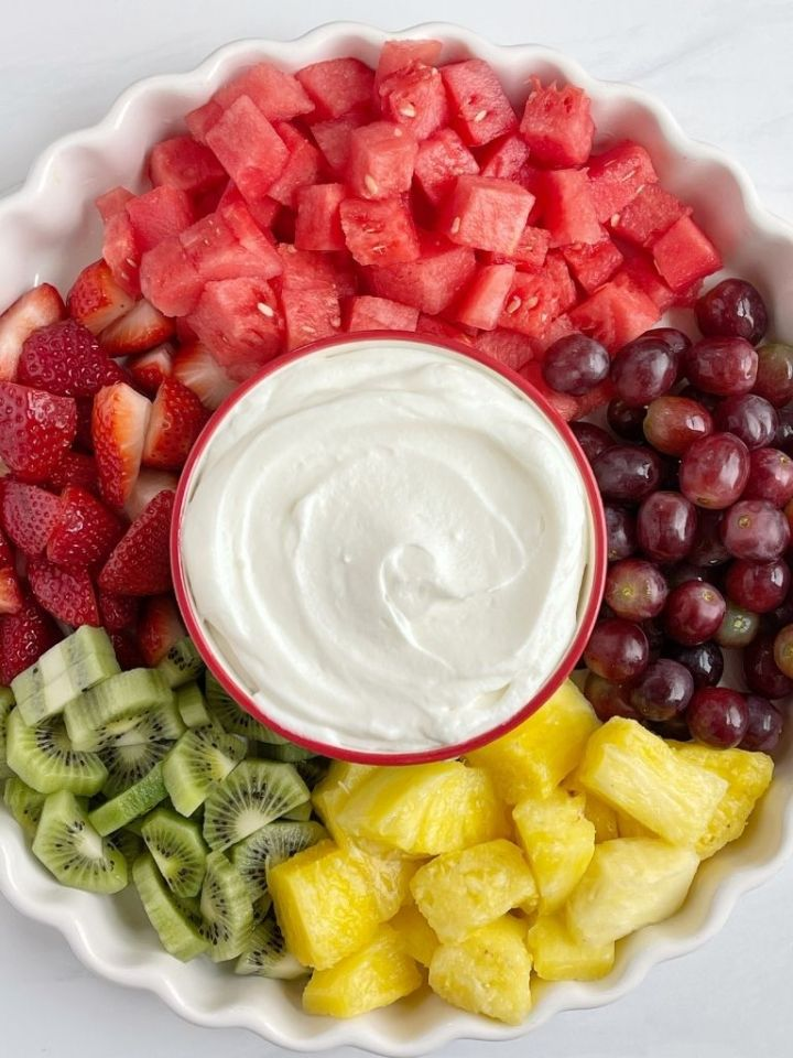 Fruit dip made with only 4 ingredients and served on a plate of fresh fruit.