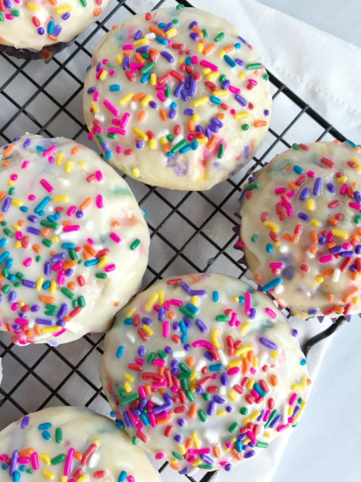 Glazed sprinkle donut muffins are so soft and taste just like a fried glazed donut with sprinkles! They are baked and not fried, and such a fun treat for the kids to make and devour.