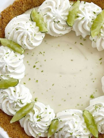 A picture of key lime pie inside a graham cracker crust and the best creamy key lime filling.