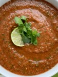 Homemade Salsa with canned whole tomatoes, stewed tomatoes, onion, garlic, jalapeno, cilantro, and seasonings. So simple to make, inexpensive, and it tastes better than anything you'll get at the restaurant or buy in the store. Mild enough for kids but can easily be made spicy!