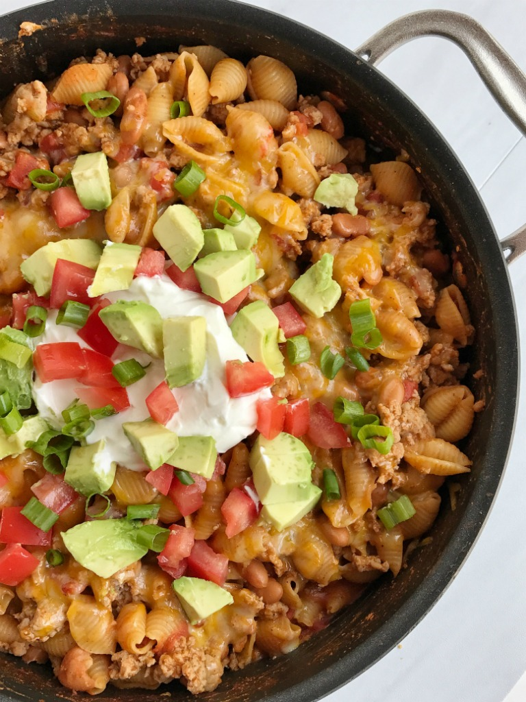 Skillet turkey taco pasta is a quick and easy 30 minute dinne recipe. Cooks in one pan on the stove top with simple ingredients. Serve with your choice of taco toppings for an easy dinner!