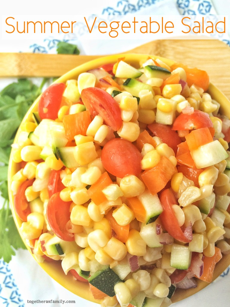 SUMMER VEGETABLE SALAD- corn, zucchini, tomato, and bell pepper covered in a sweet olive oil/honey dressing | www.togetherasfamily.com