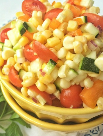 Crisp corn, zucchini, cherry tomatoes, bell pepper, and diced red onion tossed together in a sweet sauce of honey and olive oil. This summer vegetable salad is a healthier side dish for all those summer bbq's.