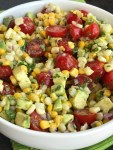 Avocado Corn Tomato Salad | Side Dish | Avocado | Healthy Recipe | Avocado Corn Tomato Salad is an easy, light, and refreshing salad! Chunks of avocado, sliced tomato and frozen corn are covered in an easy lime & olive oil dressing. Simple ingredients with amazing taste. Perfect for a light lunch, BBQ, potluck, or as a side for dinner. #healthy #salad #avocado #sidedish