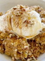 Pumpkin Pie Pecan Cobbler has a creamy pumpkin pie layer topped with a sweet spiced pecan crumble topping. Serve with a scoop of vanilla ice cream for the best pumpkin cobbler recipe that's perfect for Fall.