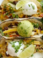 Delicous vegetable tacos are the perfect vegetarian recipe for Taco Tuesday! Cabbage, bell peppers, corn, black beans, onion, brown rice, and fresh lime.