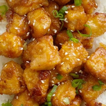 Homemade Baked Sweet & Sour Chicken is better than any take-out! Fresh and homemade with only a few ingredients. Chunks of crispy baked chicken in an easy sweet & sour sauce.