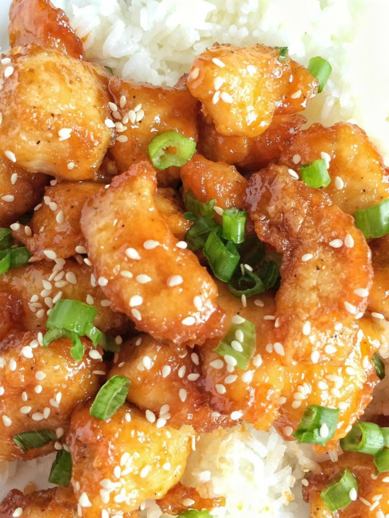 No need for expensive take-out when you can make this fresh, homemade, simple ingredient baked sweet & sour chicken at home! Chunked chicken dipped in cornstarch and egg and then it's lightly fried and then baked to perfection in the oven. An easy homemade sweet & sour sauce tops it off. Serve over rice for a delicious copycat meal right at home.