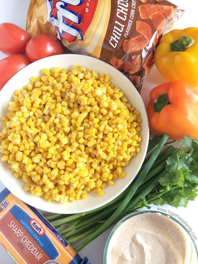 Fritos corn salad will be one salad that no one will forget! Loaded with corn, vegetables, a creamy spiced dressing, and an entire bag of Fritos Chili Cheese corn chips. So many flavors and textures. It's the perfect salad for a BBQ, picnic, or a potluck.