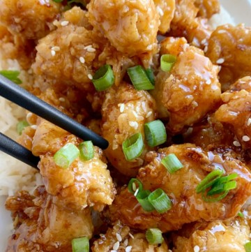 Honey Chicken has the crispiest, most delicious coating ever! Chunks of chicken dipped in seasoned flour & buttermilk, and then pan fried to crispy chicken perfection. Cover the crispy honey chicken in a sweet homemade honey sauce and serve over rice!