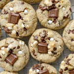 S'mores Dessert Recipes | Cookie Recipes | Smores Cookies are soft-baked, thick, and chewy. Graham cracker cookie dough base, marshmallow bits, Hershey's chocolate, and chocolate chips.