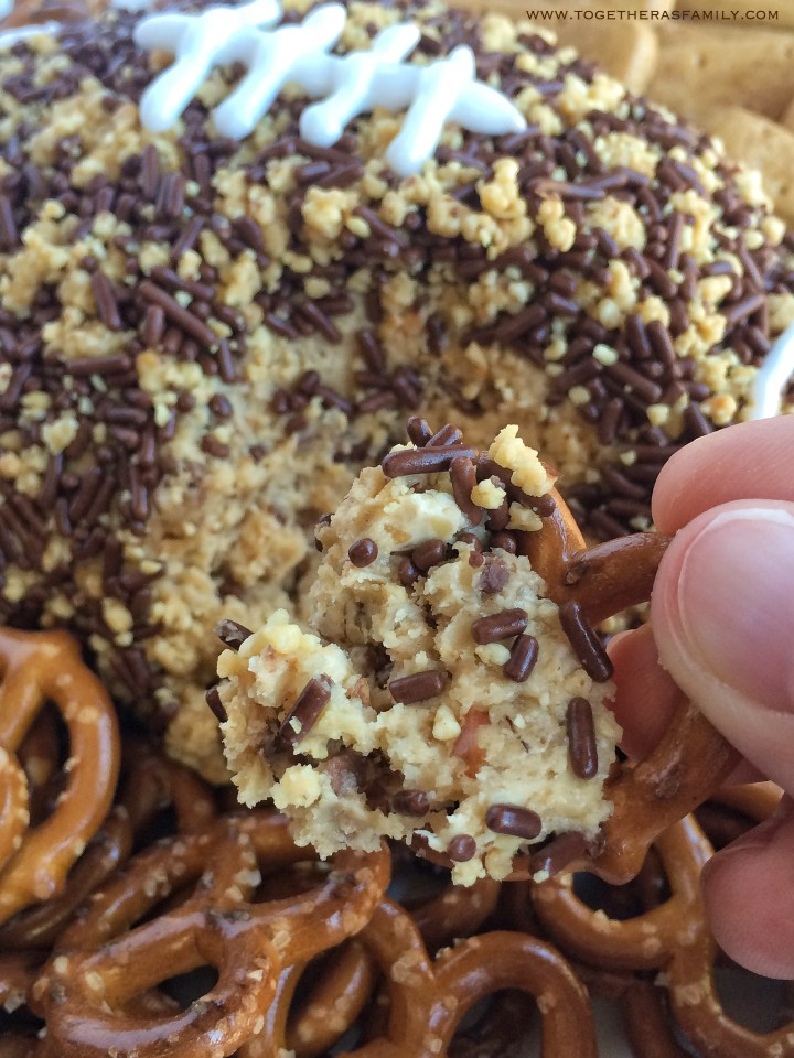 An easy oatmeal cookie dough (no egg!) with peanut butter and filled with crushed snickers peanut butter candy bars. The outside is coated in crushed peanuts and chocolate sprinkles. This stuff is so addicting!