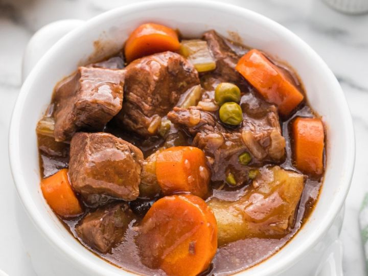 Picture of beef stew inside a white bowl.