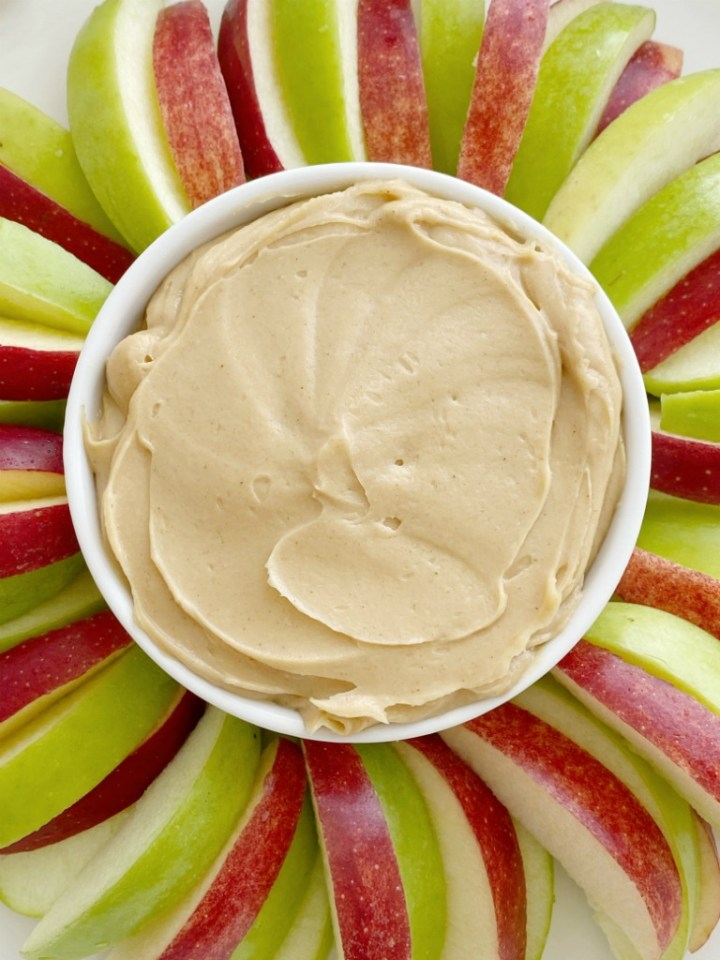 Peanut Butter Greek Yogurt Apple Dip is an easy, 3-ingredient dip that takes just seconds to prepare and it's loaded with protein! Serve with sliced apples for a healthy and delicious snack.